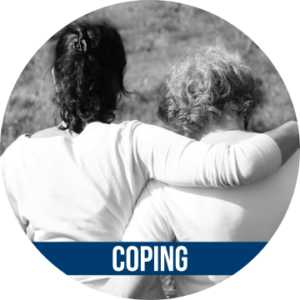 Link to COPING with image of two women supporting each other