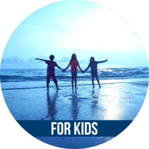 Link to FOR KIDS with image of three children holding hands on the beach