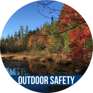 Link to OUTDOOR SAFETY with image of trees by the water